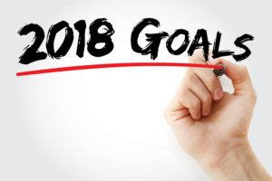 Hand writing 2018 Goals with red marker, business concept